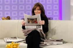 Sarah reading newspaper on TODAY show