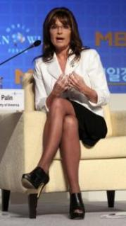 Sarah seated answers questions in Seoul Korea Oct 10 2011