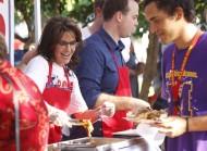 Sarah serving BBQ at Kirk Adams rally