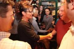 Sarah shakes man's hand at C4P meetup in Iowa