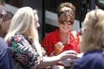 Sarah signing autograph before Patriots in the Park Tea Party rally in Belleville MI 07-14-12