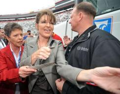 Sarah signing autographs at NASCAR 2012