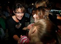 Sarah smiles as she talks with little girl at C4P meetup in Iowa