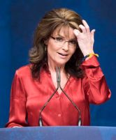 Palin fixes her hair as she addresses the Conservative Political Action Conference (CPAC) in Washington