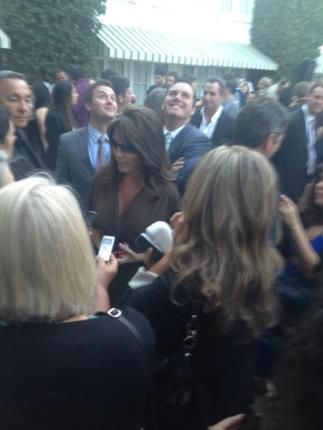Sarah surrounded by crowd at NBC party in LA