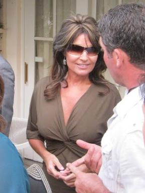 Sarah talking to man at BC party in LA