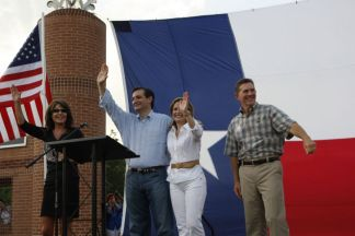 Sarah the Cruzes and Jim DeMint waving at Cruz rally