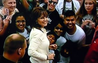 Sarah turns for a photo as she mingles with crowd after IA TPA rally