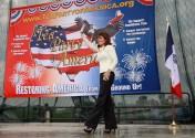 Sarah walks onto stage waving at Iowa Tea Party rally 2011