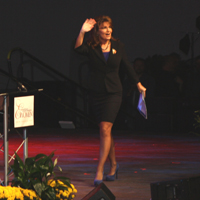 Sarah waves as she arrives onstage in Tupelo in blue suede shores - October 2011