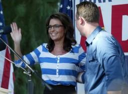 Sarah waving during speech at Kirk Adams rally