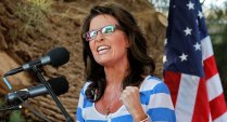 Sarah with clenched fist during speech at Kirk Adams rally