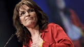 Sarah with hand on chest and determined expression during speech at CPAC 2012