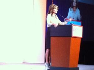 Side view of Sarah behind podium at RightOnline making Obama dog joke - Clouthier