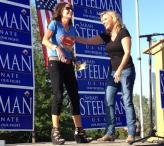 Steelman laughs as Sarah clowns during speech at Steelman rally