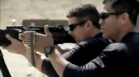 Todd aiming rifle during training by Cortes