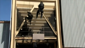 Todd and Ally rappelling down side of 8-story building