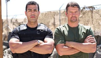 Todd and Cortes posing with arms crossed