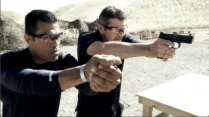 Todd fires pistol as Cortes demonstrates grip