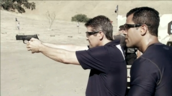 Todd fires pistol as Cortes watches