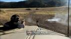 Todd fires pistol from desert patrol vehicle