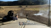 Todd fires pistol from desert patrol vehicle