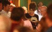 Todd watches as Sarah signs cap at C4P meetup in Iowa
