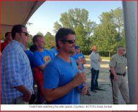 Todd watching Sarah speak at Steelman rally - August 2008
