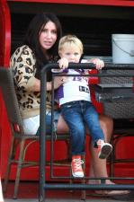 Tripp peers over rail as he sits in Bristols lap September 2011