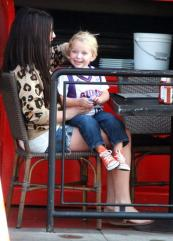 Tripp smiling as he sits in Bristols lap at lunch Sept 2011