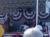 3Sarah sits on stage at Buckeye AZ Vietnam veteran memorial event