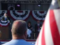 4Sarah sits on stage at Buckeye AZ Vietnam veteran memorial event