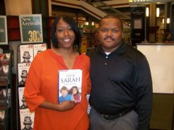 Adrienne Ross holding copy of Our Sarah