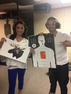 Bristol and Mark holding up targets after shooting practice