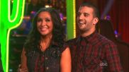 Bristol and Mark smiling as they listen to judges on DWTS