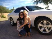 Bristol and Tripp beside her white car