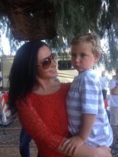Bristol wearing sunglasses holding Tripp in AZ
