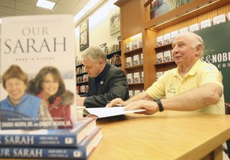 "Sarah Palin's brother and father, Chuck Heath Jr., left, and Chuck Heath Sr., authors of a new book, ""Our Sarah: Made In Alaska."", signed copies of the book at The Villages Barnes and Noble on Monday, October 1, 2012. (Tom Benitez/Orlando Sentinel)"