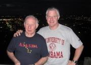 Chuck Heath Sr and Jr in Alaska and UAB T-Shirts