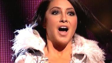 Closeup of Bristol in DWTS ice queen costume with surprised look