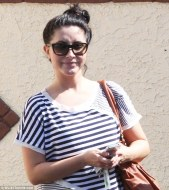 Closeup of Bristol in striped top before rehearsal