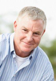 Closeup of Chuck Heath Jr in blue striped shirt