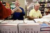 Closeup of Heaths signing books in Idaho