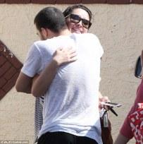 Closeup of Mark giving Bristol bear hug