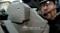 Closeup of Todd aiming grenade launcher during SES finale