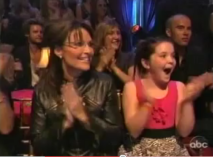 Sarah and Piper applaud during DWTS 2010