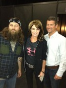 Sarah and Todd pose with Duck Dynasty actor