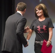 Sarah greeted by NRA Chris Cox as she arrives on stage at convention