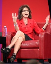 Sarah lifts her hands during question-answer session at SEU leadership forum