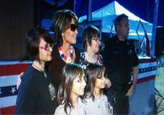 Sarah poses with adults and young girls at Buckeye AZ event